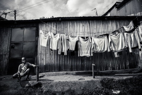 Kenyan boy in Kibera slum Nairobi Kenya