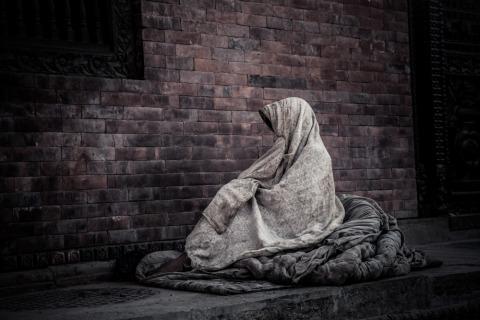 Begging woman in Kathmandu Nepal
