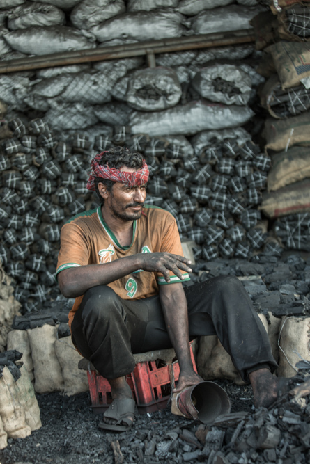 Pakistani man selling coal in Jeddah Saudi Arabia