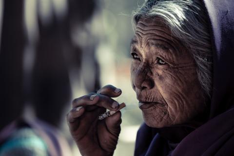 Nepali woman smoking a cigarette in Kathmandu