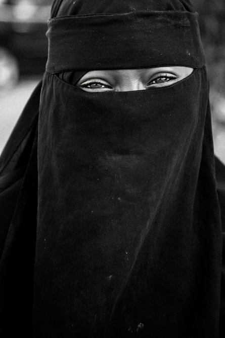 woman wearing niqab and abaya in Saudi Arabia